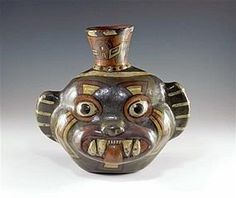 """Huari / Wari culture, ca. 300 to 600 AD. Vibrantly decorated polychrome pottery olla in the form of a snarling jaguar with large toothy smile, tongue extended, wide rounded eyes possibly representing some form of human jaguar transformation. 8""""H x 8-1/2""""W, appears intact, but professionally restored"""