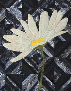 Daisy applique on a black-and-white strip quilt, in:  StrataVarious Quilts (Book) at 4 and 6 Designs