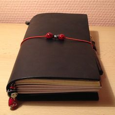 My lovely midori travelers notebook with 3 refills and a zipper refill