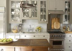 Grey or putty cabinets on cream colored walls