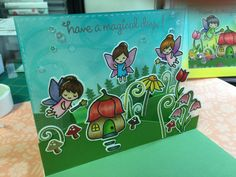 Lawn Fawn Fairy Friends- Colored images with Copics, used acetate strips to suspend the fairies