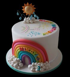 Rainbow cake with sun, rain and cloud toppers, all edible except for wires for raindrops. Fondant decorated with Americolor Food Markers. www.cakeme.com.au