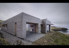 Tigh Port Na Long, Isle of Skye, by Dulchas Architects | Building study | Architects Journal  Deep window reveals frame view and provide outdoor windbreak