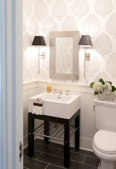 powder bathroom, powder bath, small bathroom, wallpaper, pedestal sink, stylish sconces, wall lighting, unique mirror, vero beach interior designer, cute and company