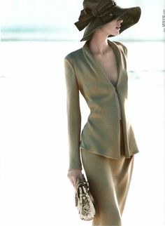 This is pushing it a bit for me..love the cut, classic...but I'd add a cream colored camisole.  MB                 Milou van Groesen for Giorgio Armani Spring 2012 Campaign