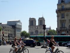 Here you can see a photo of the Place Saint Michel Square with a view of the traffic and bikes passing by, showing just how close it is to the famous Notre Dame Cathedral making it a ideal place to visit when nearby.  Daily updates at www.eutouring.com Notre Dame, Cathedral, Saints, Places To Visit, Street View, Bike, Bicycle, Bicycles, Cathedrals