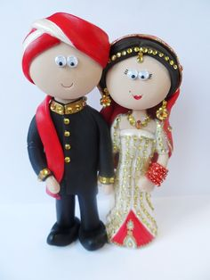 Indian Bride & Groom wedding cake topper. Totally personalised & handmade to look like the people getting married. NOT EDIBLE, last a lifetime! Any outfits/poses are possible, something like this is £149.99 for the couple, £9.99 for the base, I send my work anywhere in the World.