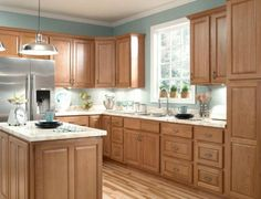 Furniture , Durable Oak Kitchen Cabinets : Honey Oak Kitchen Cabinets With Marble Countertop And Silver Refrigerator