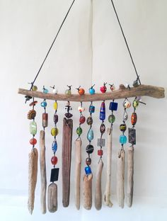 Adding some extra jingle and sparkle to your backyard with beaded wind chime does beautify your garden. So let's make a DIY beaded wind chime projects with some amounts of beautiful beads you can Driftwood Projects, Driftwood Art, Driftwood Mobile, Driftwood Ideas, Beach Crafts, Diy Crafts, Seashell Crafts, Homemade Crafts, Resin Crafts