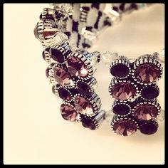 """Day 7:  Rhinestones and anger. Anger that it's 1/2"""" too small for my wrist. Then again, I have really big wrists. Will need to buy another batch of beads and expand. Sigh."""