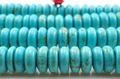 15.5 inches of Chinese Turquoise smooth rondelle beads in 4X10mm