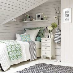 Beach house-style attic bedroom with whitewashed panelling
