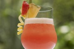 the Rum Runner is a flavorful drink packed with rum, brandy, banana, and orange and is topped with Falernum.