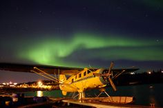 Norseman float plane under the northern lights of Yellowknife, N.W.T.