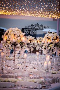 White orchids and roses with chrystal chandeliers #flowerarrangements #weddingideas #weddinginspirations # white #wedding # tabledecorations