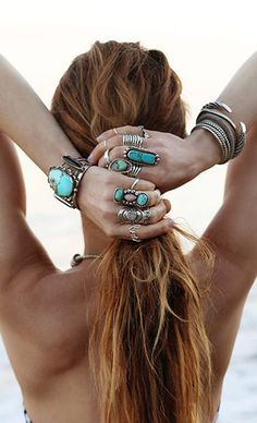 hippie boho jewelry | woman with long hair and many bracelets with turquoise as a gypsy