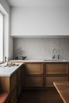 wood cabinets with minimalist marble