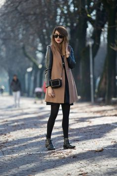 Camel-colored coat with leather sleeves, tights, booties, and mini shoulder bag.