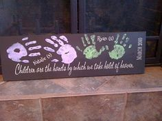black canvas with white handprints of friends and family