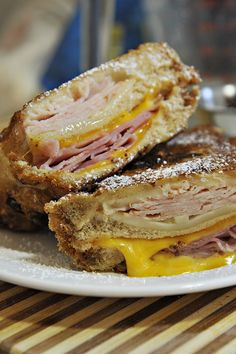 Monte Cristo Sandwiches. Amazing stuff. I don't think the pancake batter is necessary - but just dipping the sandwich in egg should do the trick. I would also add a spreading of Dijon and mayo when building the sandwich. Using challah or brioche would make the sandwich fluffier. Variations on the cheese and the side of jam would be fun too - blackberry, currant jelly, cranberry, lingonberry...