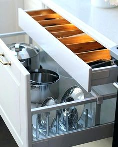 We totally love deep and wide lower cabinet drawers for all frying pans and big and heavy stuff so that you dont have to pull them out from some shelves over your head