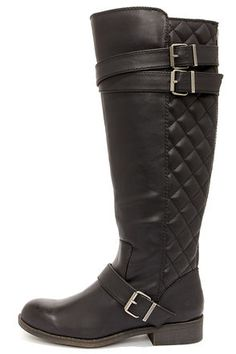 """When it comes to the Madden Girl Calinda Black Quilted Riding Boots, """"quilt-ers"""" always win! Smooth black vegan leather constructs a rounded toe upper with padded quilting decorating the back half of a 16"""" tall shaft. Three silver-buckled belted accents add a bit of intrigue, while a 12.5"""" exposed heel zipper lets you slip on and go! 1.25"""" rubber block heel. Lightly cushioned insole. Nonskid rubber sole. Available in whole and half sizes. Measurements are for a size 6. All vegan friendly…"""