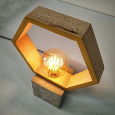 Are you someone that loves reading for a while before going to sleep? A bedroom lamp is an important part of the decor and is needed to help you see at night. Wooden Chandelier, Wooden Wall Lights, Wooden Lamp, Table Lamp Wood, Wooden Walls, Concrete Lamp, Geometric Lamp, Tall Lamps, Gifts For Office