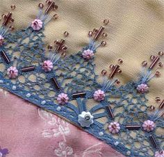 I ❤ embroidery & beadwork. . . After embroidering the seams, motifs, lace & braids on a crazy block, it's time to add what I call the 'hard' embellishments. I don't mean they are hard to do, just that as elements they are physically hard. Things like charms, buttons & beads. For me, embellishment is the last phase of a block. The size & colour of beads, charms, buttons, & lace motifs not only add interest they will influence the composition of a block. ~By SharonB, Pintangle