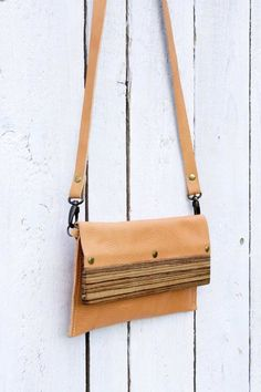 a55a859971 A lovely modern clutch bag with a detachable strap and a beautiful zebrano  wood…