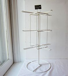 "Vintage Retail Display Rack -  Spining / Rotating / Revolving / - Metal- 12 Arms - 19"" tall, 11"" total diameter. $45.00, via Etsy."