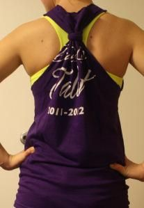 Old shirt to new tank top...mine didn't come out quite this nice, but I now have a new tank to wear to the gym!