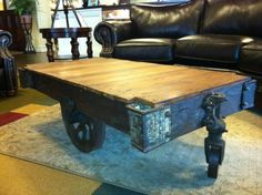 Check out this refinished antique factory cart coffee table. Factory carts we originally used throughout the US to transport goods around the factory. Since then, people have been collecting them for their character & making them into unique furniture pieces!