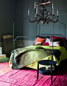 Gorgeous modern jewel tones make this bedroom roar. The deep green to neon color palette rocks. Bed is from Anthropologie.