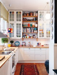 Wonderful white kitchen upper cabinets, with glass front doors. Along with butcher block counter tops.