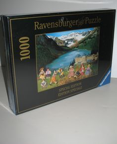 I SOLD IT ON EBAY: Fabulous Ravensburger jigsaw puzzle featuring the Pauline Paquin's art and a scene that includes many children playing in the meadows in the foreground, the Fairmont Chateau Lake Louise in the center and the beautiful Lake Louise and Rocky Mountains in the middle and rear portions of the picture. #paulinepaquin #rockymountains #lakelouise