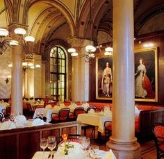 CAFÉ CENTRAL, VIENNA The Café Central is beautiful and inspirational. Housed in a historic palace, it features marble pillars, grand chandeliers, and arched ceilings that have welcomed intellectuals since the turn of the 19th century.  As is the case with most historic cafés, it now mostly welcomes tourists, but it's also a local attraction, offering live classical music in the afternoon.