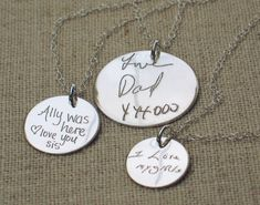 Put actual handwriting or a drawing on a necklace! Each of these necklaces has a round hand cut sterling silver charm in your choice of 3 sizes.