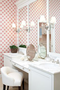 Girls bathroom - fun wallpaper with simple white details, sconces