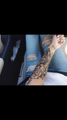 Female floral black and grey sleeve tattoo                                                                                                                                                     More