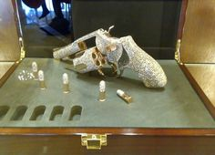 Diamond encrusted bullets and revolver.