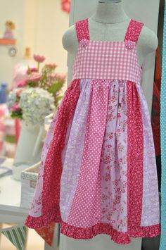 children at play dress. I like the idea of using a jelly roll to create the bottom of a dress or to sew up a skirt. I love the skirt! Sewing Kids Clothes, Sewing For Kids, Baby Sewing, Diy Clothes, Fashion Clothes, Girl Dress Patterns, Clothing Patterns, Sewing Patterns, Little Girl Dresses