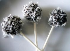 """CHOCOLATE COCONUT """"RUM"""" CAKE POPS!  1 bx Dark Chocolate Cake Mix.   2 chocolate bars that you can melt  1 cup of Coconut Rum.  2 cups of coconut flakes.  1/2 cup of Cream Cheese frosting    1: Follow cake instructions add rum. mash baked cake into crumbs while mixing in cream cheese frosting and mold into cake balls.     2: Freeze balls about 20 min.     3: Melt chocolate & Dip pops in melted chocolate. Coat pops with coconut flakes for extra crunchiness.    4: Let pops sit for 15 min. ENJOY"""