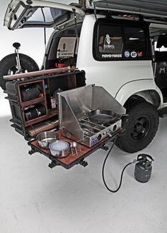 1994 toyota land cruiser fold out table with cooking equipment Jeep Camping, Camping Car Van, Kombi Motorhome, Camper Trailers, Vw Camper, Accessoires Jeep, Astuces Camping-car, Land Cruiser 80, Fj Cruiser Mods