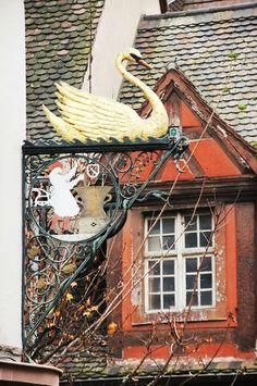 Swan shop sign in Colmar, France