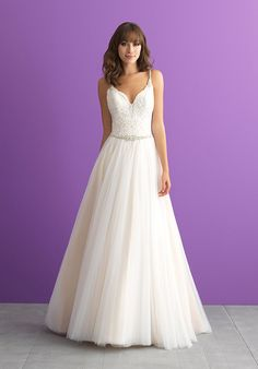 Sometimes the simplest gowns have the prettiest details - like beaded straps, a scooped back and layers of tulle.