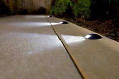Ooo, low-key lighting for a pathway. This would be nice for a driveway that can . - Ooo, low-key lighting for a pathway. This would be nice for a driveway that can be turned on/off an - Garden Path Lighting, Driveway Lighting, Exterior Lighting, Landscape Lighting, Garage Lighting, Exterior Solar Lights, Solar Garden Lights, Solar Driveway Lights, Walkway Lights