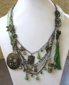 I NEED this really awesome necklace!!  https://www.etsy.com/listing/163504461/the-green-faerie-explosive-signed