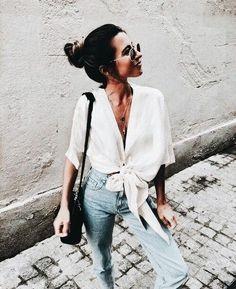 Pretty white shirt with denim jeans.
