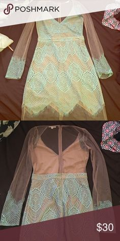 """Sheer aqua dress. This dress is stunning Sheer sleeves with the aqua trim on sleeves and sheer bottom trim of dress. The back is sheer halfway down. Gorgeous dress I'm 5'7"""" and it was too short after purchased Dresses Long Sleeve"""
