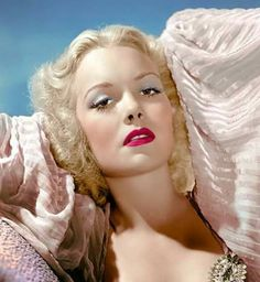 Jane Wyman, with blonde hair, beautiful.                                                                                                                                                                                 More